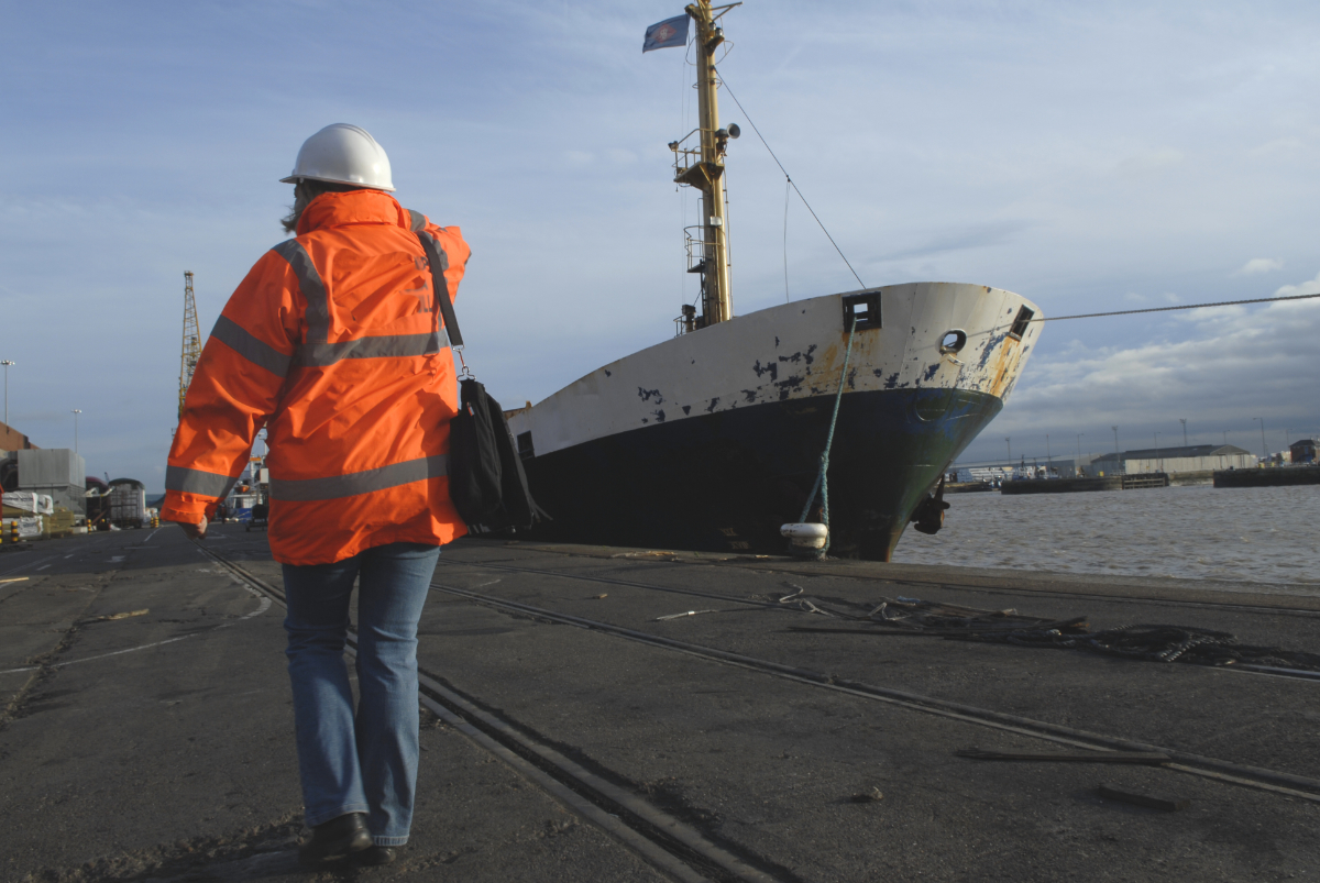 Volunteering walking towards a ship